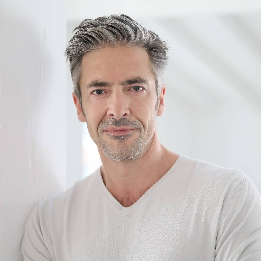 Middle Aged Man With Slick Back Hairstyle Jpg